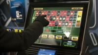 Punter trying out a new gambling machine (file picture 12/01/2013)