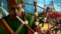 Pakistani man playing bagpipes