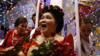 Imelda Marcos receives flowers from supporters during her 85th birthday celebration in July 2014