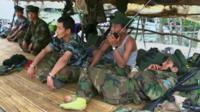 Rebels in a TNLA camp
