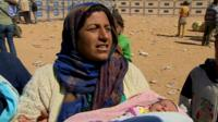 Woman with newborn baby at refugee camp