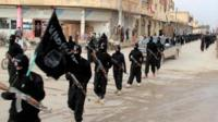 Undated file image of Islamic State militants marching in Raqqa, Syria