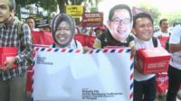 Indonesian protestors wearing masks
