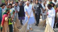Narendra Modi sweeping road
