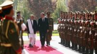 Prime Minister David Cameron is welcomed by Afghanistan's President Ashraf Ghani