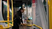 A man paying to get on the nightbus