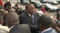 President Kenyatta amongst supporters and photographers on the steps of the ICC