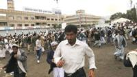 People flee after a suicide attack in Sanaa