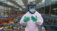 BBC reporter Danny Savage wears a protective Ebola suit