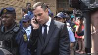 Oscar Pistorius leaves court on 13 October 2014