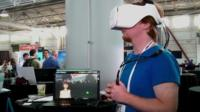 Lochlainn Wilson of Fove demonstrates eye-tracking helmet