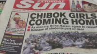 "Nigerian newspaper with headline ""Chibok girls coming home"""