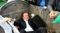 Politician in waste bin