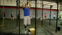 Man with prosthetic limbs doing exercises