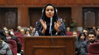 Reyhaneh Jabbari speaking to defend herself during the first hearing of her trial for the murder of a former intelligence official.