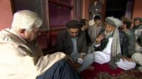 The BBC's John Simpson with local men in Kabul