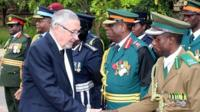 Dr Guy Scott greeting defence and security chiefs on Wednesday