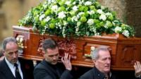 Lynda Bellingham's husband Michael Pattemore and sons carry her coffin