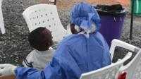 Ebola patient and health worker in West Africa