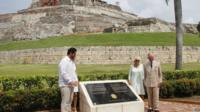"""Prince Charles and his wife Camilla, Duchess of Cornwall pose with Cartagena""""s Mayor Dionisio Velez (L) Cartagena, Colombia, on October 31, 2014."""