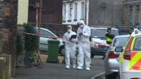 Forensics officers at the scene