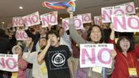 Protesters in Japan Kagoshima prefecture assembly hall trying to disrupt vote on restarting two nuclear reactors
