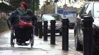 Woman in wheelchair in London