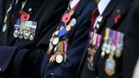 World War II veterans display their medals and poppies