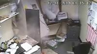CCTV still showing an ATM machine being taken