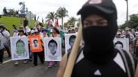 Students, peasants and other people demonstrate against the suspected massacre of 43 missing Mexican students, in the proximities of Acapulco's airport, in the Mexican state of Guerrero State, on November 10, 2014