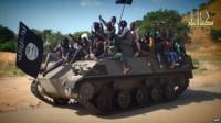 Still from Boko Haram video shows Boko Haram fighters parading on a tank