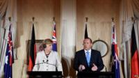 Australian Prime Minister Tony Abbott (R) and German Chancellor Angela Merkel answer questions during a joint press conference at Admiralty House in Sydney, Australia