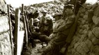 Men in trenches