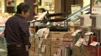 Man looks at shop display