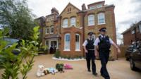 police at a house in New Malden, south London, after the discovery of three dead children at the address