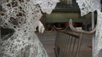 A broken glass is seen after protesters broke at the Legislative Council in Hong Kong Wednesday, Nov. 19, 2014