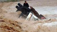 People on an overturned truck in Morocco