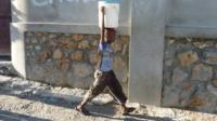Boy carrying water in Haiti
