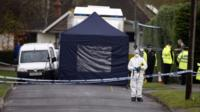 Police at the scene in Fetcham, Surrey