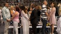 Couples marry during a massive wedding ceremony at the Maracanazinho gymnasium, in Rio de Janeiro, Brazil