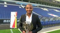 Yacine Brahimi holds his trophy