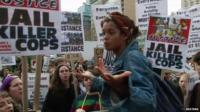 Girl addressing protesters at pro-Ferguson rally in New York City
