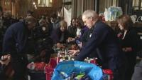 Archbishop of Canterbury Justin Welby sorting cans of food