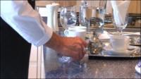 A butler preparing tea