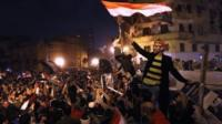 Egyptians celebrate in Tahrir Square after hearing the news of the resignation of Egyptian President Hosni Mubarak on February 11, 2011 in Cairo, Egypt.