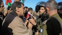 Ziad Abu Ein (L) during a confrontation with Israeli soldiers in the context of a protest in the West Bank village of Turmus Aya, 10 December 2014