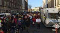 Thousands of people are attended protests in Dublin and Cork, as Shane Harrison reports.