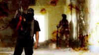 A militant holds a gun