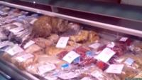 The cat in the fish counter