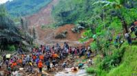 Rescue workers at site of landslide